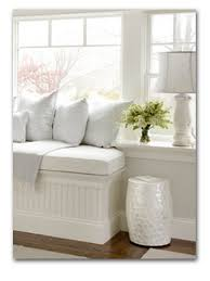 designing a window seat ideas in modern home living room apartment white window seat with cushions and houseplants on small pot also desk lamp with white lampshade
