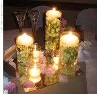Wedding Centerpieces Floating Candles And Flowers by Rose Petals Line Floating Candles In Glass Pillar Vases Mixed