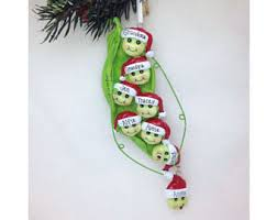 peas in a pod ornament two peas in a pod with christmas hat s ornament
