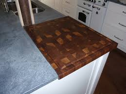 walnut wood countertop end grain chopping board in a stone