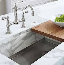 kitchen island cutting board sink with marble lip built to fit a cutting board light and