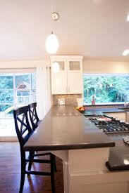 8 best fabuwood wellington kitchen in ivory glaze completed by dk this beautiful kitchen remodel included the addition of a spacious breakfast bar with taupe quartz countertops