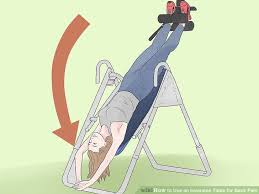 inversion table how to use how to use an inversion table for back pain 15 steps