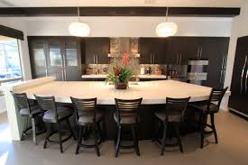 kitchen island with cooktop and seating cow pattern rug area