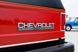 chevrolet suburban red chevrolet suburban evolution of an icon