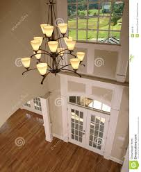 luxury entrance foyer with hanging light royalty free stock