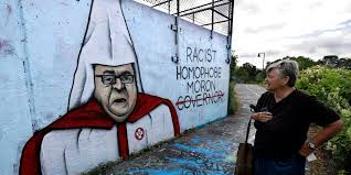 defaced paul lepage mural shows governor in mickey mouse ears lepage mural kkk