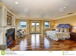 bedroom large elegant master bedroom with fireplace stock photo