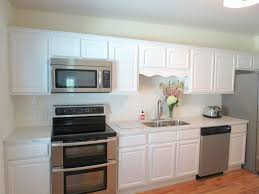 simple kitchen backsplash kitchen room wood floors with light cabinets simple white
