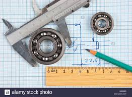 technical tools on a background of graph paper stock photo