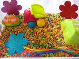 rainbow sensory bin made with fruit loops educational edible