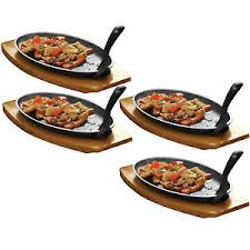 set of 4 cast iron sizzler dishes serving plates platter wooden