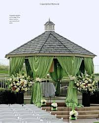 wedding backdrop set up ceremony statement is made with the curtains small cluster of
