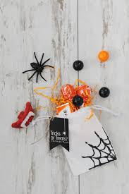 diy halloween trick or treat bags with glitter spiderwebs pink