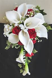 roses and lilies roses white calla lilies cascading bouquet