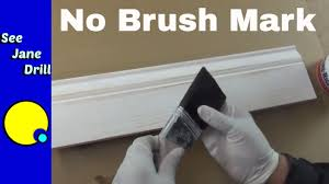 how to paint kitchen cabinets without streaks the secret to getting a paint finish with no brush marks