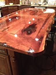 floor and decor mesquite fossills and stones inlaid into mesquite wood bar top my style