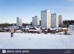 In Law Housing A Man Walks Through Snow In Sunderland England The High Rise
