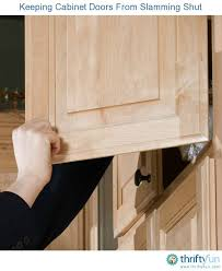 how to stop cabinet doors from slamming keeping cabinet doors from slamming shut cabinet doors