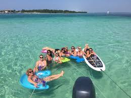 rent a boat and paddleboard and spend the day at crab island