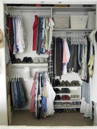 small coat closet organization with white cubicle rstorage