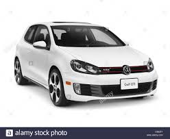 white volkswagen white 2011 volkswagen golf gti isolated car with clipping path on