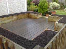 The Backyard by Deck And Patio With Hardwood Floor Tiles And Soil Mix For Raised
