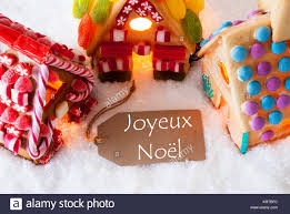 label with text joyeux noel means merry colorful