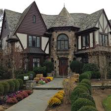 tudor home restored 150 stained glass windows and steel frames in this tudor
