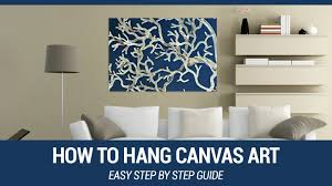 how to hang canvas art in your home or office youtube