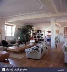 White Skin Rug Faux Zebra Skin Rug On White Sofa In Living Area Of A Nineties