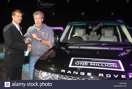 land rover one clarkson accepts one millionth range rover on behalf of help for