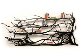 artist finds fallen tree branch on road turns it into shelf