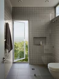 in this bathroom a tall window opens wide to let fresh air in be