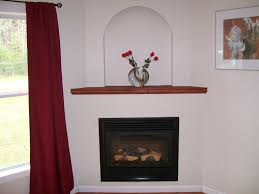 simple corner fireplace with shelf above it fireplace options