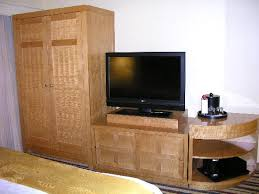 wardrobe closet dresser cabinet and tv in the bedroom picture
