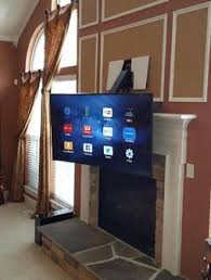 television over fireplace tv over fireplace mounting and installation services charlotte nc