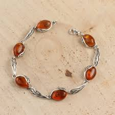 amber bracelet images Honey baltic amber sterling silver bracelet with leaf edged design jpg