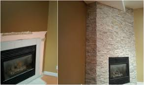fireplace makeover stone tiling an ugly duckling to a beauty