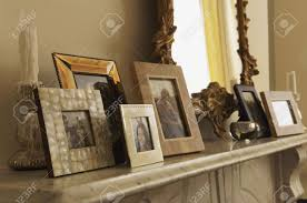 fireplace mantel with framed pictures stock photo picture and