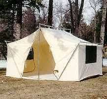 this is a canvas wall tent with a wood stove for heat and cooking