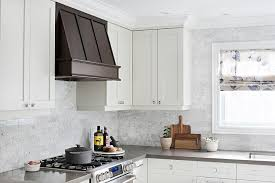 Kitchen Vent Hood Designs by Small Kitchen With Gray Cabinets And Shiny Brass Hardware