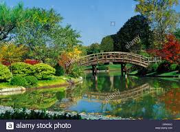 Missouri Botanical Gardens Wooden Curved Bridge Pond In The Missouri Botanical Garden