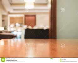 table top with blurred home interior decoration stock photo