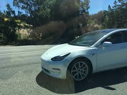 pre release tesla model 3 spotted with stunning glass roof inverse