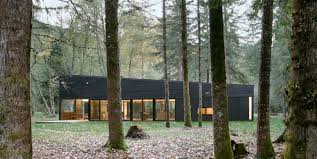 forest house forest house on a river with a dark exterior and a courtyard