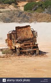 old jeep abandoned and rusty old jeep on the beach denham western australia