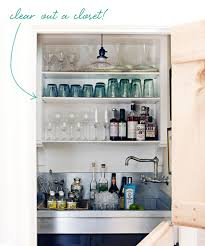 bar in closet looks like dutch door with storage below i like