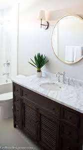 bathroom remodel using a shutter vanity from restoration hardware