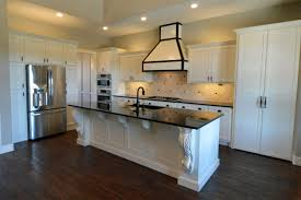 open kitchen plan with large island custom white cabinets large